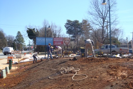 Digging and planting begin on the bare hill of the Public Orchard at the corner of Smith and Prescott Streets in downtown Greensboro, NC.