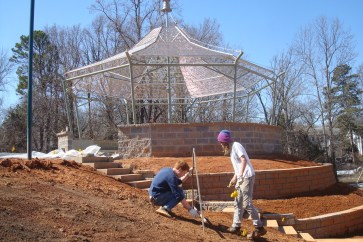 Johhny and Josh flag the contour line for a second swale. Beautiful gazebo behind.
