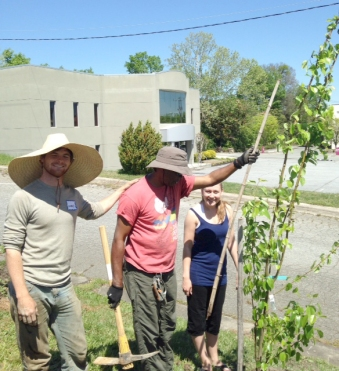 Aubrey, Bobbe and a student from UNCG plant fruit trees.