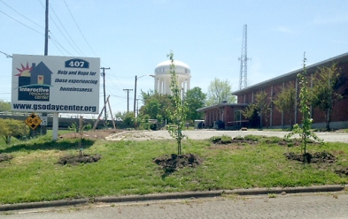 Charlie's fruit orchard which faces Greensboro's Downtown Greenway.