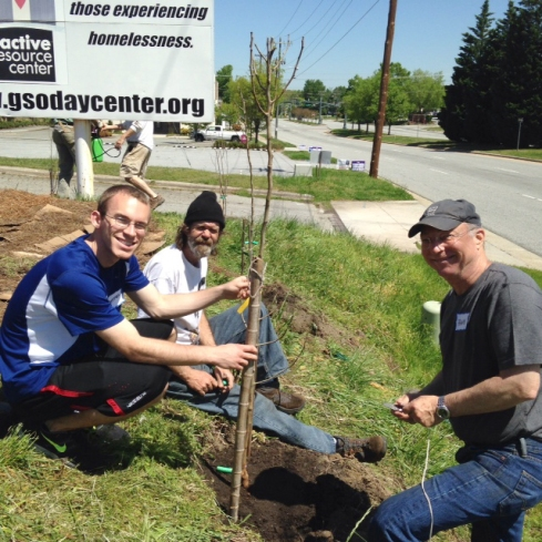 David, Hank and a UNCG student plant fruit trees.