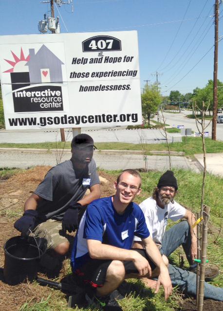 David and volunteers planting trees.