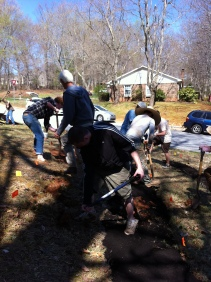 Digging and gathering of compost (back left).