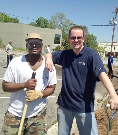 UNCG entrepreneur students volunteer with planting.