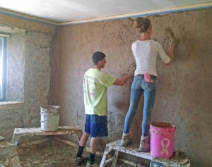 """Photo and comment by Amanda Albert. """"This is the rough coat, or """"brown"""" coat of plaster on our straw bale walls. This can be 1/4"""" to 1/2"""" thick."""""""